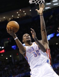 Oklahoma City Thunder forward Kevin Durant (35) shoots in front of Miami Heat forward LeBron James during the fourth quarter of an NBA basketball game in Oklahoma City, Thursday, Feb. 20, 2014. Miami won 103-81. (AP Photo/Sue Ogrocki)