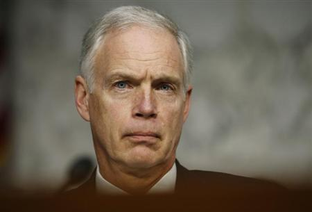 U.S. Senator Ron Johnson (R-WI) listens to Secretary of State Hillary Clinton respond to questions about the September attack on U.S. diplomatic sites in Benghazi, Libya during a hearing held by the U.S.Senate Foreign Relations Committee on Capitol Hill in Washington, January 23, 2013. REUTERS/Jason Reed