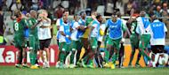 Burkina Faso's players celebrate beating Ghana on penalties on February 6, 2013 in Nelspruit. Burkina Faso drew with Nigeria in a Group C opener before whipping Ethiopia, holding title-holders Zambia and edging Togo through an extra-time goal and Ghana on penalties
