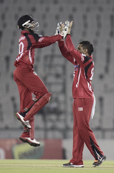 T&T players celebrate fall of wicket during the CLT20 match between Trinidad & Tobago and Sunrisers Hyderabad at Mohali, Chandigarh on Sept. 24, 2013. (Photo: IANS)