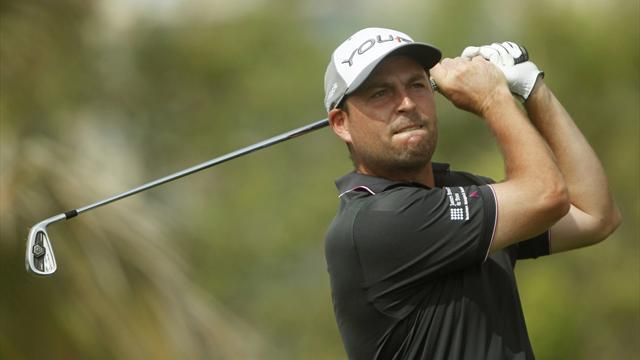 Golf - Howell comes through the pain to win Dunhill title