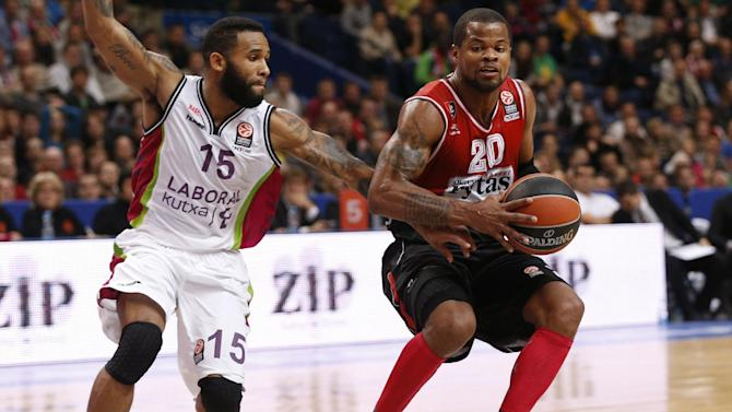 Walter Hodge, left, of  Spain's BC Laboral Kutxa Vitoria  is challenged by Omar Cook  from  Lithuania's BC Lietuvos Rytas during the Euroleague basketball match  in Vilnius, Lithuania, Wednesday, Oct. 30, 2013