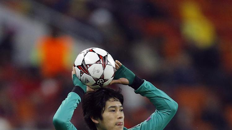 Schalke's Atsuto Uchida of Japan, prepares to throw a ball during a Champions League Group E soccer match against Steaua, at the National Arena in Bucharest, Romania, Tuesday, Nov. 26, 2013