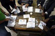 Election officials count ballots at a polling station in Cairo on December 15, 2012. Egypt's opposition has called for mass protests on Tuesday after Islamists backing President Mohamed Morsi claimed victory in the first round of a referendum it alleges was riddled with polling violations