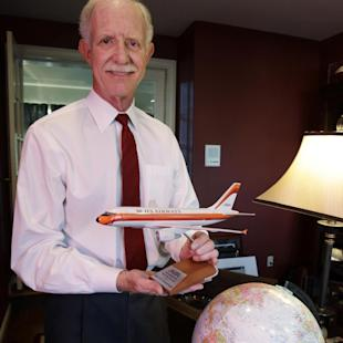 """FILE - In this Jan. 10. 2011 file photo, Chesley """"Sully"""" Sullenberger captain of the US Airways flight #5149 that landed in New York's Hudson River in 2009, poses in his office at his home in Danville, Calif. Clint Eastwood will follow up his box-office sensation """"American Sniper"""" with a biopic of Capt. Chesley """"Sully"""" Sullenberger. Warner Bros. announced Tuesday, June 2, 2015, that Eastwood will direct and produce the as-yet-untitled drama as his next film.  (AP Photo/Paul Sakuma, File)"""