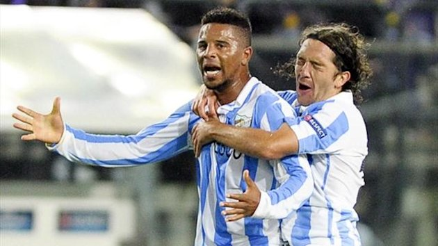 Malaga's Eliseu celebrates against Anderlecht (Reuters)
