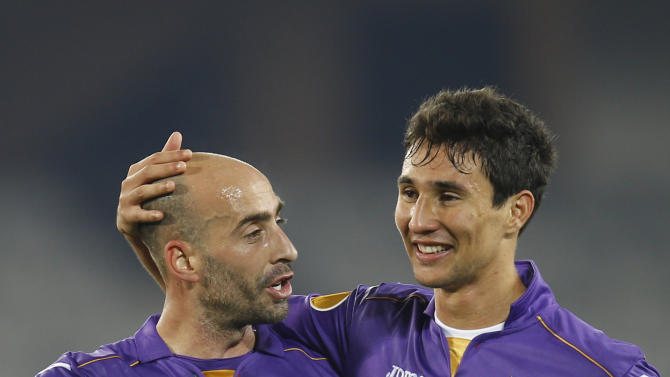 Fiorentina's Borja Valero, left, and Ryder Matos, right, celebrate at the end of an Europa League, group E match, between Fiorentina and Pandurii, at the Cluj Arena stadium in Cluj, Romania, Thursday, Nov. 7,  2013