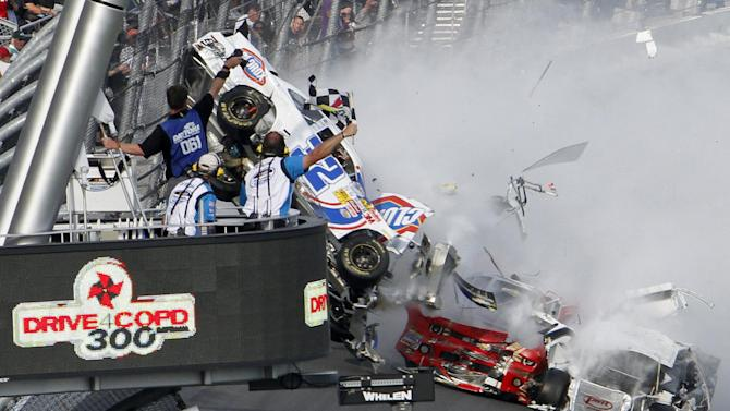 Kyle Larson's car (32) gets airborne during a multi-car wreck on the final lap of the NASCAR Nationwide Series auto race Saturday, Feb. 23, 2013, at Daytona International Speedway in Daytona Beach, Fla. (AP Photo/David Graham)
