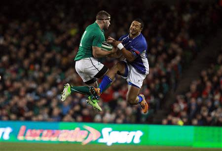 Ireland's Fergus McFadden is challenged by Samoa's Brando Vaaulo in their international rugby union match at Aviva stadium in Dublin
