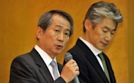 CEO of Japan's top brokerage Nomura Holdings, Kenichi Watanabe (left) speaks as Nomura Securities president Koji Nagai listens during a press briefing in Tokyo. Top Japanese brokerage Nomura Holdings said that it would temporarily cut its most senior executives' pay by as much as half in the wake of an embarrassing insider trading scandal at the firm