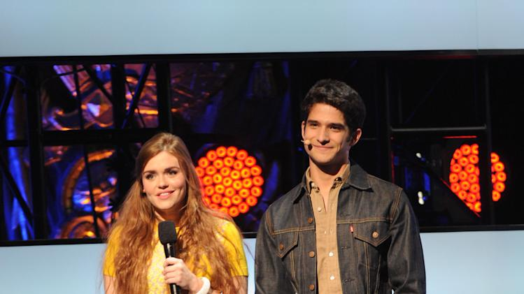 "IMAGE DISTRIBUTED FOR MTV - From left, Tyler Posey and Holland Roden introduce their new show ""Teen Wolf"" at the 2013 MTV Upfront, on Thursday, April 25, 2013 at the Beacon Theater in New York. (Photo by Scott Gries/Invision/AP Images)"