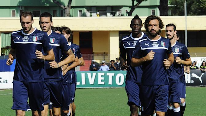 The Italian national team runs during a training session at the Giarrusso stadium in the outskirts of Naples, Monday, Oct. 14, 2013, ahead of a 2014 FIFA World Cup, Group B, qualification match against Armenia in Naples on Tuesday.  Other teams in Group B are, Denmark, Bulgaria, Czech Republic, and Malta