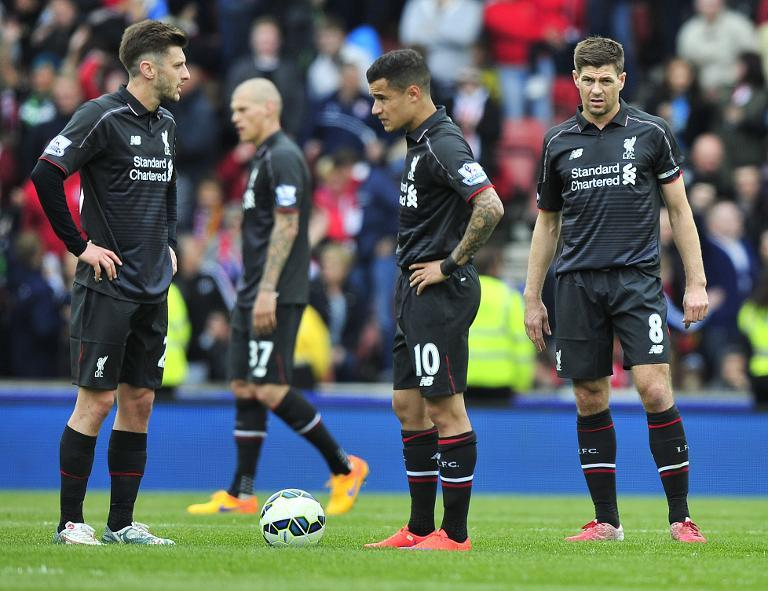 Liverpool players concede a goal during the match against Stoke City in Stoke-on-Trent, on May 24, 2015