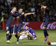 Barcelona's midfielder Xavi Hernandez (C) celebrates with forward Lionel Messi (L) and Jordi Alba after scoring during the Spanish league football match Valladolid vs FC Barcelona at the Jose Zorilla stadium in Valladolid on December 22, 2012. Barcelona won 3-1