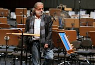 "Lebanese composer Marcel Khalife is pictured during a rehearsal with the Qatar Philharmonic Orchestra, presenting choral compositions inspired by the Arab Spring, at the Doha Opera House in the Qatari capital on February 3, 2013. The famous Lebanese composer enthralled a Qatari audience with his Arab Spring-inspired suite ""Oriental"" in Doha"