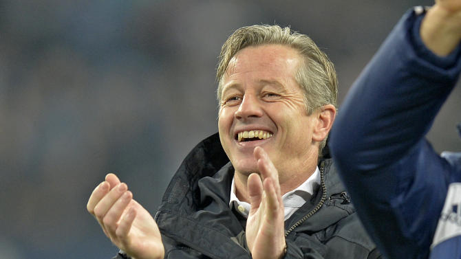 Schalke head coach Jens Keller aplauds after the German Bundesliga soccer match between FC Schalke 04 and SC Freiburg in Gelsenkirchen, Germany, Sunday, Dec. 15, 2013