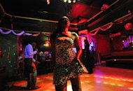 A woman dances in a nightclub in Bangui, Central African Republic, on January 3, 2013. In Bangui, nightclubs have become dayclubs because of a curfew in place across the city due to a rebel advance