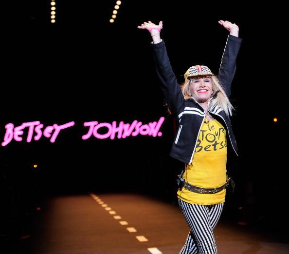 Instead of bowing, Betsey does a signature cartwheel at the end of her runway show to prove she's still got it. Another show well done.