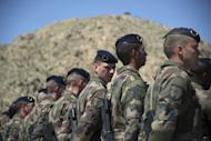 French soldiers, pictured during a transition ceremony with Afghan troops at Surobi base, in April. France's defence minister arrived in Afghanistan Sunday, the day after an attack that killed four French soldiers and an announcement that France would begin withdrawing troops in July
