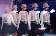This multiple exposure shot shows a model walking on the catwalk during a fashion show in Manila on November 29, 2012
