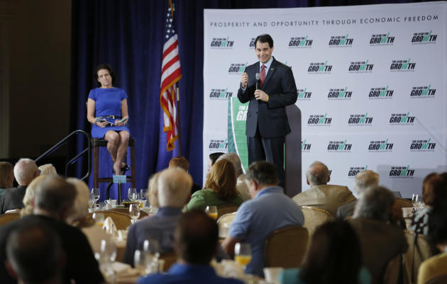 Wisconsin Gov. Scott Walker responds to a question from board member Frayda Levin after he spoke at the winter meeting of the free market Club for Growth winter economic conference at the Breakers Hot