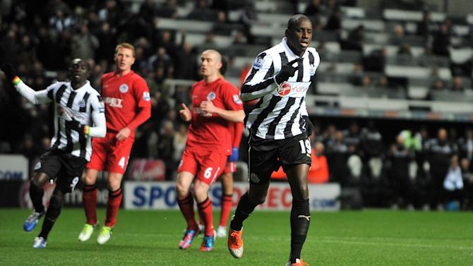 Demba Ba, right, strides away after tucking away the opening goal from the penalty spot