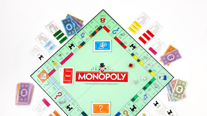 This product image provided by Hasbro, shows the board game Monopoly. The end is near for the shoe, wheelbarrow or iron in the classic Monopoly game as fans vote Tuesday, Feb. 5, 2013 in the final hours of a contest to determine which token to eliminate and which piece to replace it with. (AP Photo/Hasbro, File)