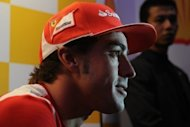 Ahead of the Singapore Grand Prix Ferrari driver Fernando Alonso says he has set his sights on matching Ayrton Senna's career haul of three world titles after equalling his boyhood idol's number of podium finishes