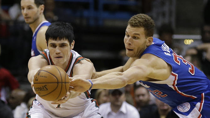 Los Angeles Clippers (32) Blake Griffin steals the ball against Milwaukee Bucks' Ersan Ilyasova, left, during the first half of an NBA basketball game, Monday, Jan. 27, 2014, in Milwaukee