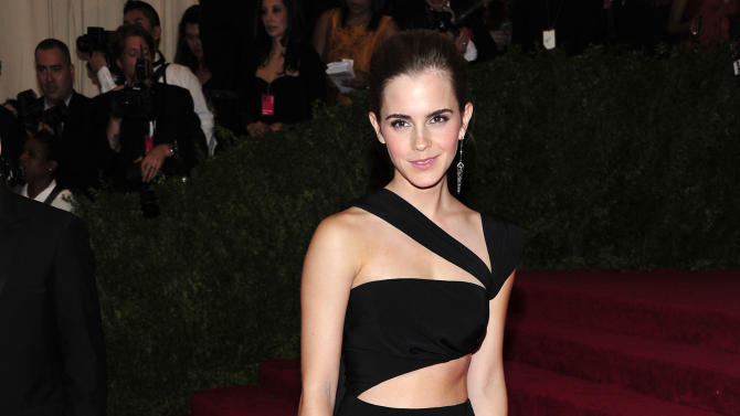 """Emma Watson attends The Metropolitan Museum of Art's Costume Institute benefit celebrating """"PUNK: Chaos to Couture"""" on Monday, May 6, 2013, in New York. (Photo by Charles Sykes/Invision/AP)"""