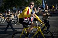 Bradley Wiggins, pictured in July 22, made a low-key return home Monday after his historic Tour de France win, even as Britain looked forward to the cyclist leading the country to more success at the London Olympics
