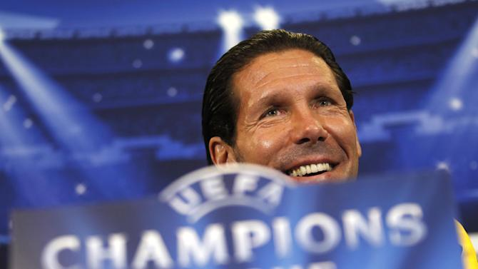 Atletico Madrid's coach Pablo Simone, from Argentina, smiles during a news conference at the Vicente Calderon stadium in Madrid, Tuesday, Nov. 5, 2013. Atletico Madrid will play against Austria Vienna in a Champions League Group G soccer match on Wednesday