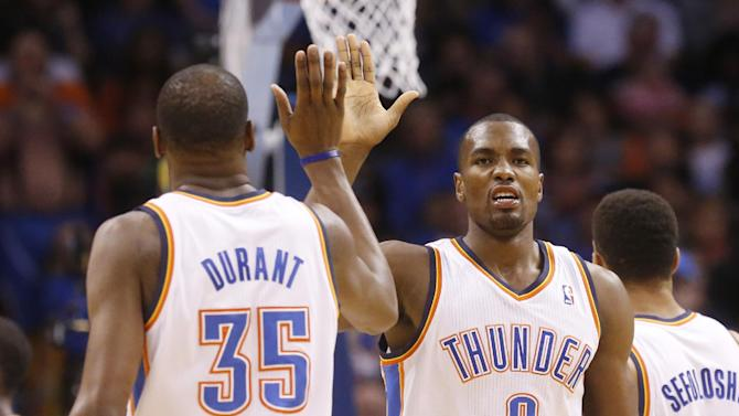 Oklahoma City Thunder forward Serge Ibaka (9) high fives teammate Kevin Durant (35) in the first quarter of an NBA basketball game against the Sacramento Kings in Oklahoma City, Sunday, Jan. 19, 2014
