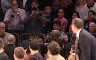 Feb 8, 2017; New York, NY, USA; New York Knicks former player Charles Oakley (center) is removed from his seat by security as fans and the Knicks bench watch during the first quarter between the New York Knicks and the Los Angeles Clippers at Madison Square Garden. Brad Penner-USA TODAY Sports