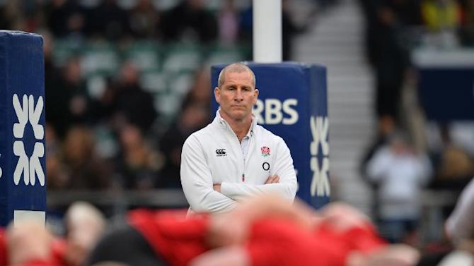 England's coach Stuart Lancaster looks on ahead of the Six Nations international rugby union match between England and France at Twickenham Stadium on March 21, 2015