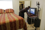 Sgt. Leo Dunson pulls up one of his rap music videos at his apartment,Thursday, April 26, 2012, in Las Vegas. While working to earn a degree in political science, Dunson focuses much of his engergy on building a career in rap with music that focuses on his journey serving in Iraq with the Army and his battle with PTSD. (AP Photo/Julie Jacobson)