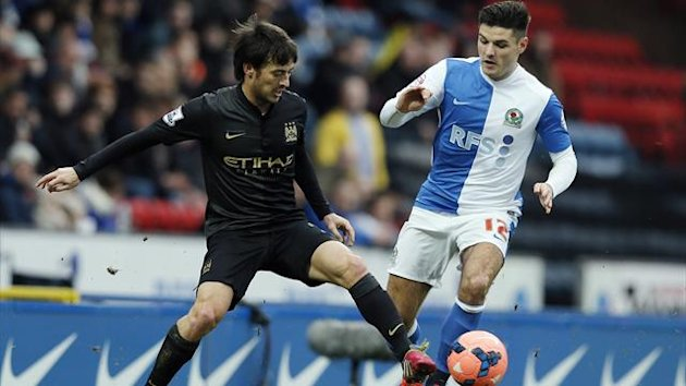 2014Manchester City's David Silva challenges Blackburn Rovers' Ben Marshall during their FA Cup third round match at Ewood Park in Blackburn
