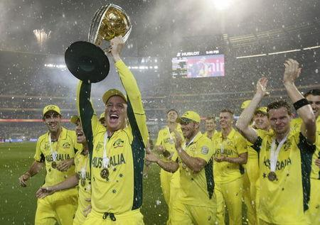Australia's wicket keeper Haddin holds aloft the Cricket World Cup trophy alongside team mates after they defeated New Zealand in the final match at the Melbourne Cricket Ground