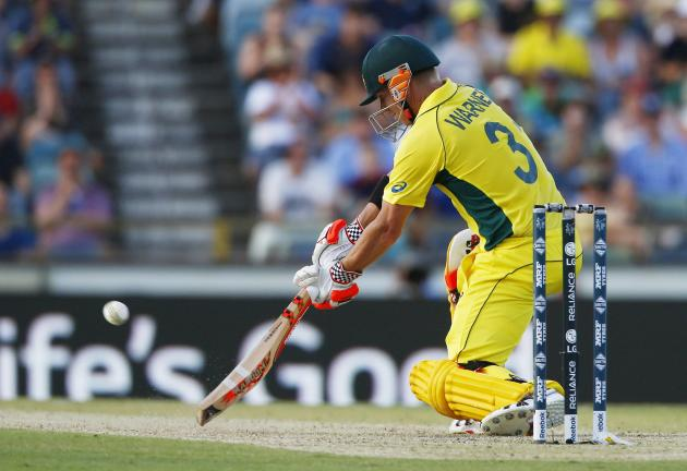 Australian batsman David Warner plays the ball to the boundary during their Cricket World Cup match against Afghanistan in Perth