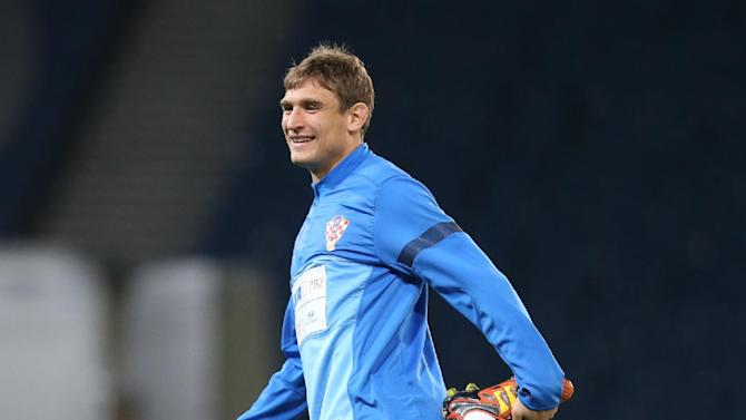 Croatia's Nikica Jelavic stretches during a team training session at Hampden Park, Glasgow, Scotland, Monday Oct. 14, 2013. Croatia face Scotland in a World Cup qualifying Group A  soccer match on Tuesday