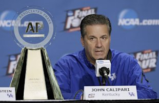 John Calipari sits by his AP College Basketball Coach of the Year trophy Friday. (AP)