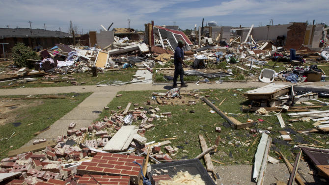George Thomas, 71, walks through the debris of the Rosedale Community where his brother-in-law lives in Tuscaloosa, Ala., Thursday, May 5, 2011. Authorities are continuing the search for victims over a week after killer tornadoes swept across the state.  (AP Photo/Dave Martin)