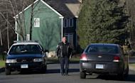 Police block a road near the house of Nancy Lanza, mother of Adam Lanza, on December 15, 2012 in Sandy Hook, Connecticut. Lanza, 20, was identified by authorities as the black-clad killer who fatally shot his mother in her home, gunned down 26 children and adults at Sandy Hook Elementary School, and then committed suicide on December 14