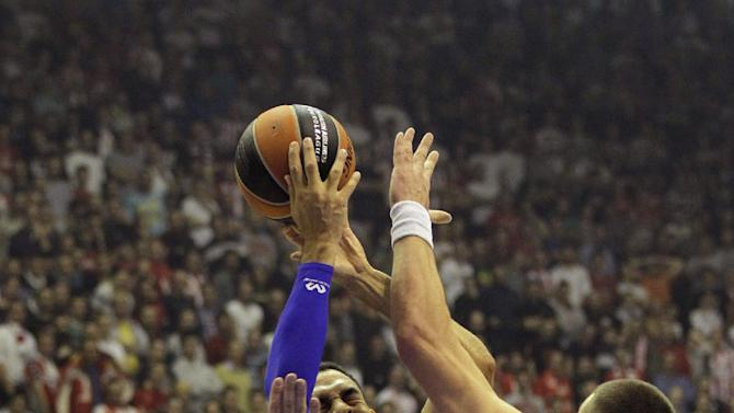 David Blu of Maccabi Electra Tel Aviv, center, challenges for the ball with Red Star's Ivan Radenovic, left and Rasko Katic during their Round 7, Group D, Euroleague basketball match in Belgrade, Serbia, Thursday, Nov. 28, 2013