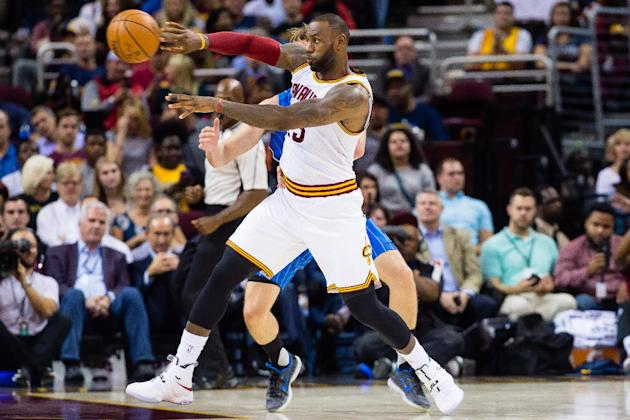 Basketball - LeBron's Cavs, Durant-led Warriors favored as season begins