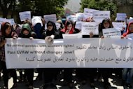 A demonstration in Kabul last month in support of a draft law to curb violence against women. The WHO blamed taboos that prevent victims from coming forward, failings in medical and justice systems, and norms that mean men and women may see violence as acceptable