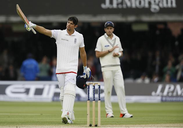 England's Alastair Cook celebrates scoring 150 during the fourth day of the first Test match between England and New Zealand at Lord's cricket ground in London, Sunday, May 24, 2015. (AP Photo