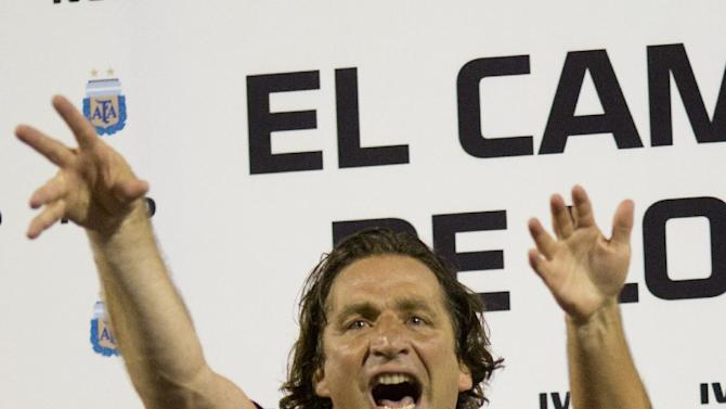 San Lorenzo's coach Juan Antonio Pizzi  celebrates at the end of an Argentina soccer league final match against Velez Sarsfield in Buenos Aires, Argentina, Sunday, Dec. 15, 2013. San Lorenzo won the Argentine first division championship