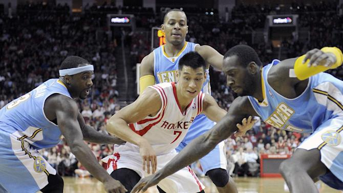Houston Rockets' Jeremy Lin (7) goes for a loose ball with Denver Nuggets Ty Lawson, left, Randy Foye, center rear, and J.J. Hickson, right, in the second half of an NBA basketball game Saturday, Nov. 16, 2013, in Houston. The Rockets won 122-111