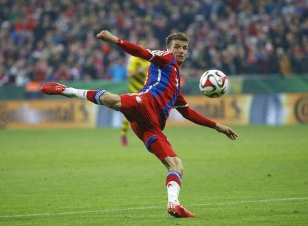 Bayern Munich's Mueller kicks the ball during German Cup semi-final soccer match against Borussia Dortmund in Munich